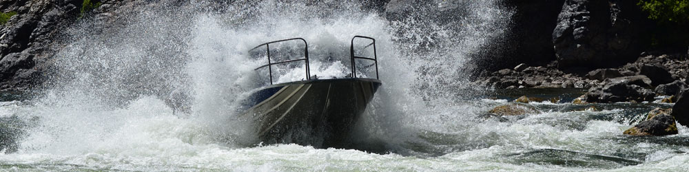 Crashing through the waves in an adventurous jet boat ride with Kilgore Adventures.