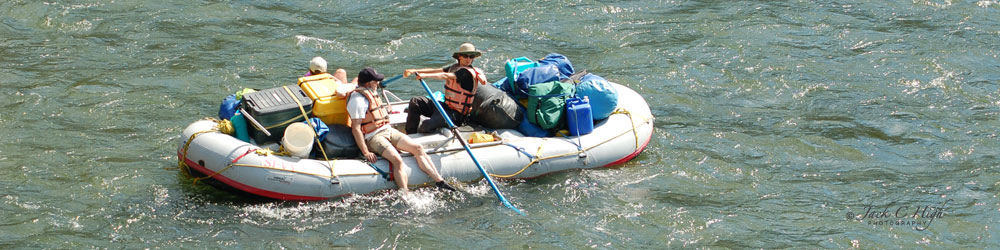 Rafting the Clark Fork River with a loaded raft