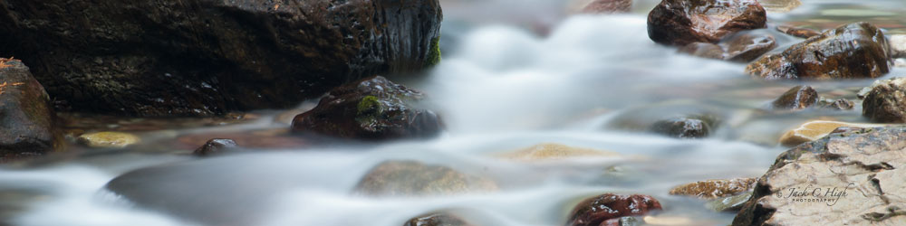 Misty water covering rocks