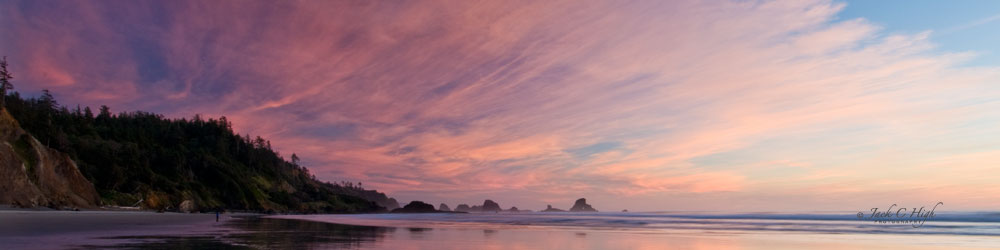 Brilliant pink fan shaped sunset over Cannon Beach.