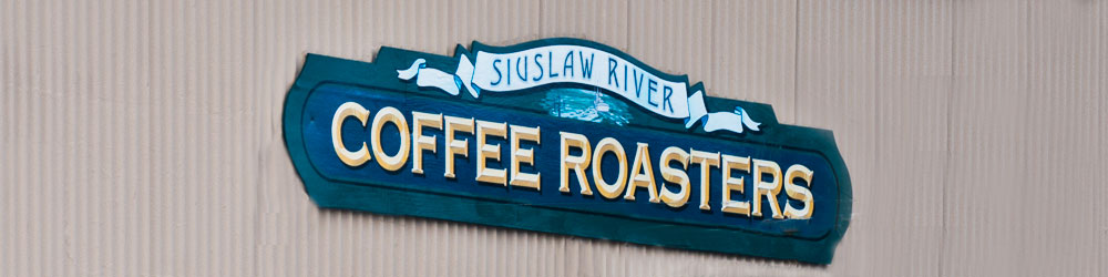 Sign for Siuslaw River Coffee Roasters in Florence
