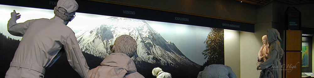 Exhibit of natives and explorers looking at Mt St Helens inside visitor center